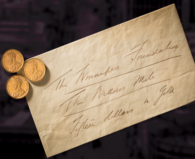 Three gold coins with an old envelope.